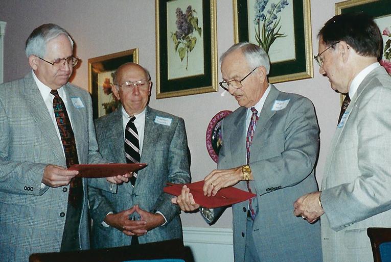 District Superintendents: Rev. Ed Sells (left), Rev. Walter Ellisor, Kent Hall, and Rev. Langdon Garrison
